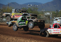 Apr 16, 2011; Surprise, AZ USA; LOORRS driver Casey Currie (2) and Kyle Leduc (99) during round 3 at Speedworld Off Road Park. Mandatory Credit: Mark J. Rebilas-.
