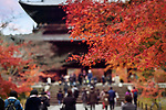 Artistic abstract scenery of people passing through The Sanmon, the main gate of Nanzen-ji historic Zen Buddhist temple in Sakyo-ku, Kyoto, Japan 2017 Image © MaximImages, License at https://www.maximimages.com