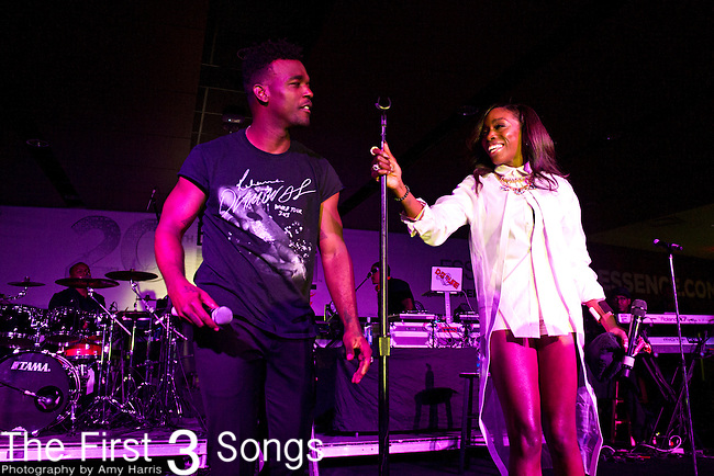 Luke James performs with Estelle during the 2014 Essence Festival at the Mercedes-Benz Superdome in New Orleans, Louisiana.