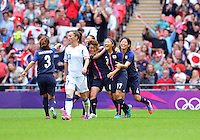 August 06, 2012..Japan's Azusa Iwashimizu #3, Mizuho Sakaguchi #6, Yuki Ogimi #17 and Saki Kumagai #4 celebrate after scoring against France during Semi Final match at the Wembley Stadium on day ten in Wembley, England. Japan defeats France 2-1 to reach Women's Finals of the 2012 London Olympics.