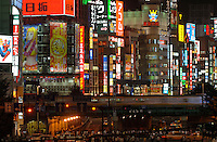 A typical and very Japanese cityscape in the Shinjuku, Tokyo, Japan. It is full of entertainment and shopping areas. Department store, electronics, restaurants and bars can be found most in this area..27 Jul 2006