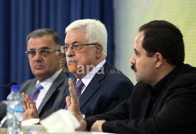 """Palestinian Authority president and head of the Fatah movement Mahmud Abbas attends a Fatah """"Revolutionary Council"""" meeting in the Palestinian West Bank city of Ramallah along with top officials on October 26, 2011, as the Fatah Revolutionary Council members continue discussing the bid for UN membership, and a French compromise proposal which would see the Palestinian status upgraded to that of a non-member state. Photo by Mufeed Abu Hasnah"""