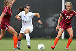 02 October 2011: Duke's Gilda Doria (21) plays the ball between Virginia Tech's Shannon Mayrose (4) and Kelly Conheeney (13). The Duke University Blue Devils defeated the Virginia Tech Hokies 1-0 at Koskinen Stadium in Durham, North Carolina in an NCAA Division I Women's Soccer game.