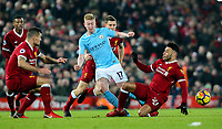 Manchester City's Kevin De Bruyne is tackled by Liverpool's Alex Oxlade-Chamberlain, Dejan Lovren and James Milner<br /> <br /> Photographer Alex Dodd/CameraSport<br /> <br /> The Premier League - Liverpool v Manchester City - Sunday 14th January 2018 - Anfield - Liverpool<br /> <br /> World Copyright &copy; 2018 CameraSport. All rights reserved. 43 Linden Ave. Countesthorpe. Leicester. England. LE8 5PG - Tel: +44 (0) 116 277 4147 - admin@camerasport.com - www.camerasport.com