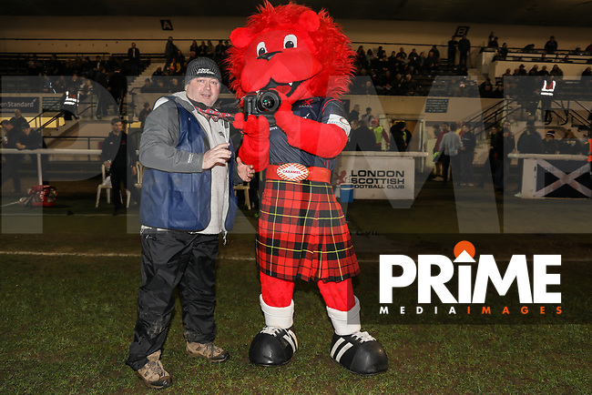 The London Scottish mascot takes a photo with photographer Liam McAvoy of the Jersey Post ahead of the Greene King IPA Championship match between London Scottish Football Club and Jersey Reds at Richmond Athletic Ground, Richmond, United Kingdom on 16 March 2018. Photo by David Horn.