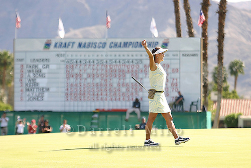 March 28, 2004; Rancho Mirage, CA, USA;  Grace Park celebrates her first major victory after sinking a birdie putt to win the LPGA Kraft Nabisco golf tournament held at Mission Hills Country Club.  Park won the tournament by one stroke over Aree Song with an overall score of 11 under par 277.  She finished the day with a 3 under par 69.<br />