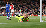 Leicester's Kasper Schmeichel makes a save during the Premier League match at the Emirates Stadium, London. Picture date: April 26th, 2017. Pic credit should read: David Klein/Sportimage