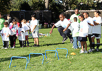 "High jumping participant during a  D.C United clinic in support of first lady Michelle Obama's ""Let's Move"" initiative on the White House lawn, in Washington D.C. on October 7 2010."
