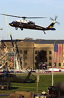 11 September 2017 - America remembers the fateful day of 9/11/2001 on the commemoration on the 16th anniversary of the terrorist attacks that killed nearly 3,000 people when hijackers flew commercial airplanes into New York's World Trade Center, the Pentagon and a field near Shanksville, Pennsylvania File Photo: Sep 12, 2001; Washington, DC, USA; President BUSH arrives via helicopter to view &amp; inspect the Pentagon damage first hand after firefighters extinquished the flames. <br /> CAP/ADM/LF<br /> &copy;LF/ADM/Capital Pictures