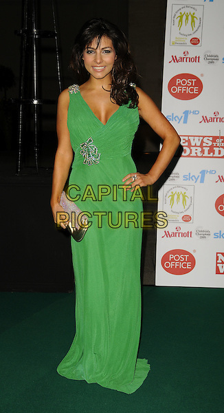 ROXANNE PALLETT.Children's Champions Awards 2009 at the Grosvenor House Hotel, Park Lane, London, England..March 4th 2009..full length green long maxi dress hand on hip silver gold clutch bag sparkly diamante .CAP/CAN.©Can Nguyen/Capital Pictures.