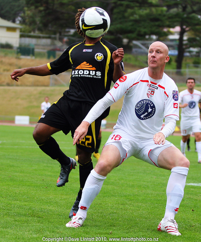 Wellington's Michael Fifii and Waitakere's Neil Emblen compete for the ball during the NZFC soccer match between Team Wellington and Waitakere United at Newtown Park, Wellington, New Zealand on Sunday, 14 February 2010. Photo: Dave Lintott / lintottphoto.co.nz