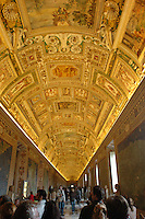 People walk through the long halls of the Vatican Museum in Rome, Italy March 2, 2006. (Photo by Alan Greth)