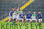 Kerry's John Egan and Jack Goluding ready to pounce on the loose ball against Limerickl during their NHL Div 1B clash in Fitzgerald Stadium on Sunday