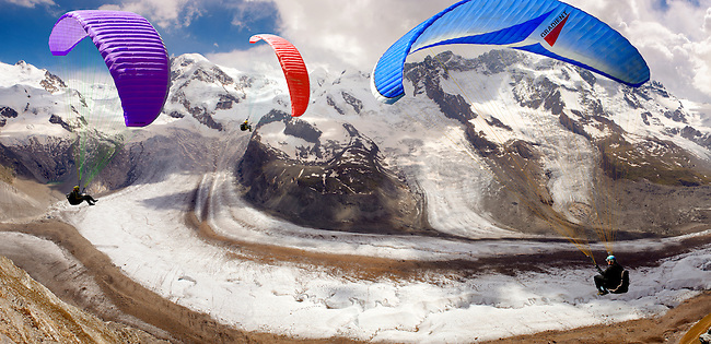Paragliders over the Gornergletscher  glacier above Zermatt Switzerland