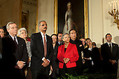 Washington, DC - October 28, 2009 -- United States Attorney General Eric Holder and U.S. Senator Dick Durbin (Democrat of Illinois), left, listen as U.S. President Barack Obama delivers remarks at a reception commemorating the enactment of the Matthew Shepard and James Byrd Jr. Hate Crimes Prevention Act in the East Room of the White House, October 28, 2009..Mandatory Credit: Pete Souza - White House via CNP