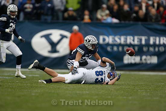 The ball gets away from Air Force's Kevin Fogler (83), with BYU's Lee Aguirre (20) defending. BYU vs. Air Force college football Saturday, November 21 2009.