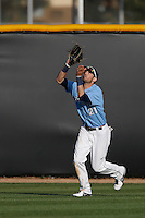 Louie Lechich #21 of the University of San Diego Toreros waits to catch a fly ball during a game against the Cal State Northridge Matadors at Matador Field on March 26, 2013 in Northridge, California. (Larry Goren/Four Seam Images)