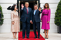 US President Donald J. Trump (C-L) and First Lady Melania Trump (R) welcome Korean President Moon Jae-in (C-R) and Mrs. Kim Jung-sook (L) to the South Portico of the White House in Washington, DC, USA, 11 April 2019. President Moon is expected to ask President Trump to reduce sanctions on North Korea in an attempt to jump start nuclear negotiations between North Korea and the US.<br /> Credit: Jim LoScalzo / Pool via CNP/AdMedia