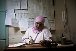 Linda Yussef, midwife at the Haifa Hospital of Burj el Barajneh, does paperwork at the beginning of her nightshift.<br /> <br /> Linda Yussef, sage-femme &agrave; l'h&ocirc;pital Haifa de Burj El Barajneh, commence sa nuit de garde