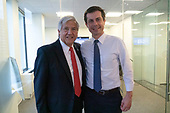 Mayor Pete Buttigieg takes a photo with Greg Rosenbaum, venture capitalist and Dem donor and former chair of the National Jewish Democratic council during a communal parlor meeting at the offices of Bluelight Strategies in Washington D.C., U.S. on May 23, 2019.<br /> <br /> Credit: Stefani Reynolds / CNP