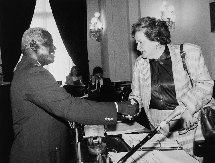Rep. Mary Rose Oakar, D-Ohio, shaking hands. (Photo by CQ Roll Call)