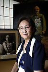 "Yuko Tojo, granddaughter of Japan's wartime leader, General Hideki Tojo, poses with a family photo taken with her grandfather when she was 2 at her home in Tokyo. Gen. Hideki Tojo - who ordered the attack on Pearl Harbor -- was charged and hanged as a war criminal after World War II when Yuko was just 6. Though she remembers little of her grandfather she still regards him as a hero. ""Japan did not fight a war of aggression but in self-defense,"" says Ms. Tojo, widely seen as a leading figurehead in a recent surge in nationalism in Japan and who unsuccessfully ran for a seat in Japan's House of Councilors in 2007. ""Schoolchildren are told what evil things our country and their ancestors did during the war and this has led to a lack of pride in the Japanese people. This is wrong. We must reinstall a sense of pride and confidence in our children."""