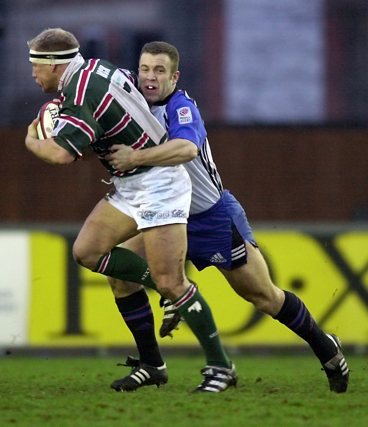 Photo. Richard Lane. .Leicester v Bath. Zurich Premiership. 16/12/2000..Kevin Maggs tackles Neil Back.