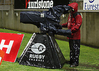 A weatherproofed Sky TV cameraman shoots from the corner. Air New Zealand Cup rugby match - Taranaki v Auckland at Yarrows Stadium, New Plymouth, New Zealand. Friday 9 October 2009. Photo: Dave Lintott / lintottphoto.co.nz
