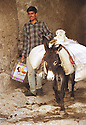 Iraq 1999.Young man with his donkey leaving Amadia.Irak 1999.Jeune homme avec son ane a la sortie de Amadia