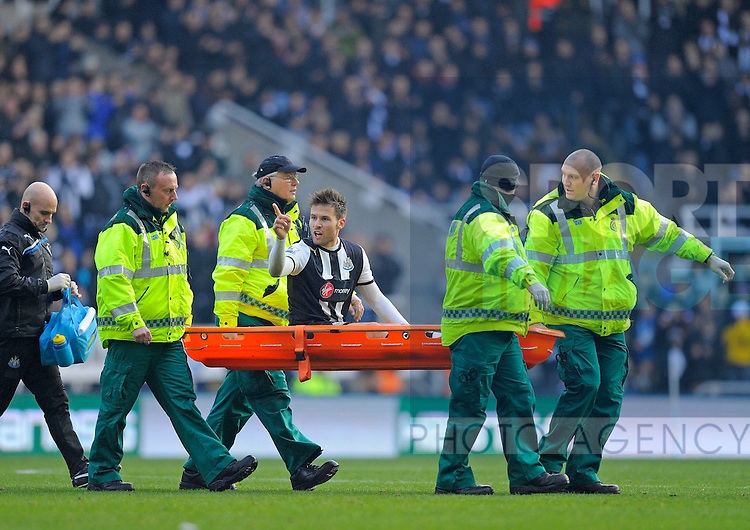 Yohan Cabaye of Newcastle United (C) points the finger at Shaun Derry of Queens Park Rangers (not in picture) as he is stretchered off..Barclays Premier League.Newcastle United v Queens Park Rangers at The Sports Direct Arena, Newcastle upon Tyne.15th January, 2012.--------------------.Sportimage +44 7980659747.picturedesk@sportimage.co.uk.http://www.sportimage.co.uk/.Editorial use only. Maximum 45 images during a match. No video emulation or promotion as 'live'. No use in games, competitions, merchandise, betting or single club/player services. No use with unofficial audio, video, data, fixtures or club/league logos.