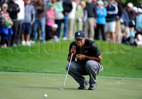 02.03.2013 Florida, USA. Tiger Woods lines up his putt at the 11th hole during the third round of the Honda Classic at the PGA National Resort & Spa in Palm Beach Gardens, FL.