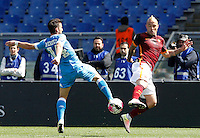 Calcio, Serie A: Roma vs Napoli. Roma, stadio Olimpico, 25 aprile 2016.<br /> Napoli&rsquo;s Dries Mertens, left, is challenged by Roma&rsquo;s Radja Nainggolan during the Italian Serie A football match between Roma and Napoli at Rome's Olympic stadium, 25 April 2016.<br /> UPDATE IMAGES PRESS/Riccardo De Luca