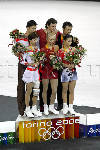 13 February 2006:  The medal winners on the podium after the Pairs Free Skating at the Palavela during the Turin Winter Olympics. Tatiana Totmianina and Maxim Marinin (RUS) won gold, Zhang Dan and Zhang Hao (CHN) won silver, Zhao Hongbo and Shen Xue (CHN) took bronze. Photo: Neil Tingle/actionplus..060211 torino figure skating dancing female woman male man dance medal ceremony
