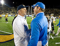California head coach Jeff Tedford shakes hands with UCLA head coach Jim Mora after the game at Memorial Stadium in Berkeley, California on October 6th, 2012.  California defeated UCLA, 43-17.