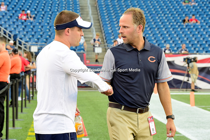 Thursday, August 18 2016: New England Patriots offensive coordinator (left) shakes hands with brother Ben McDaniels who is the Bears offensive quality conditioning coach before a pre-season NFL game between the Chicago Bears and the New England Patriots held at Gillette Stadium in Foxborough Massachusetts. The Patriots defeat the Bears 23-22 in regulation time. Eric Canha/Cal Sport Media