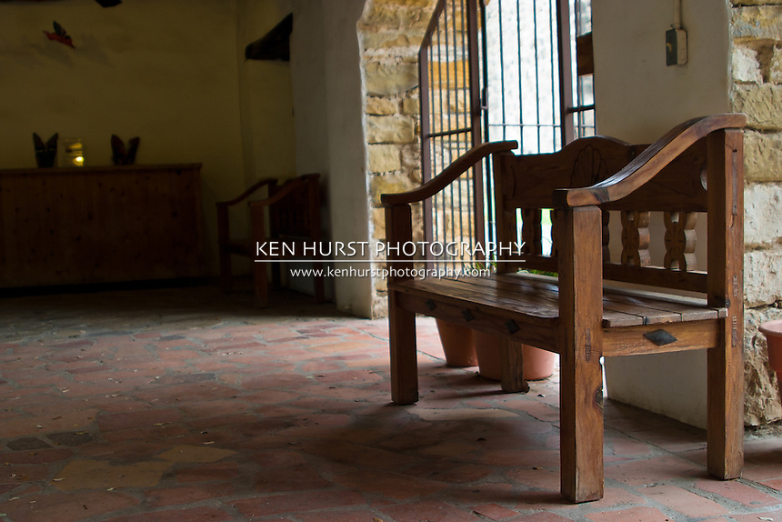 Wooden bench in an enclosed courtyard or patio of Mission San Jose in San Antonio, Texas part of the San Antonio Missions National Historical Park.