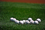 16 June 2012: A grouping of baseballs lie on the turf during batting practice prior to a game between the New York Yankees and the Washington Nationals at Nationals Park in Washington, DC. The Yankees defeated the Nationals in 14 innings by a score of 5-3, taking the second game of their 3-game series. Mandatory Credit: Ed Wolfstein Photo