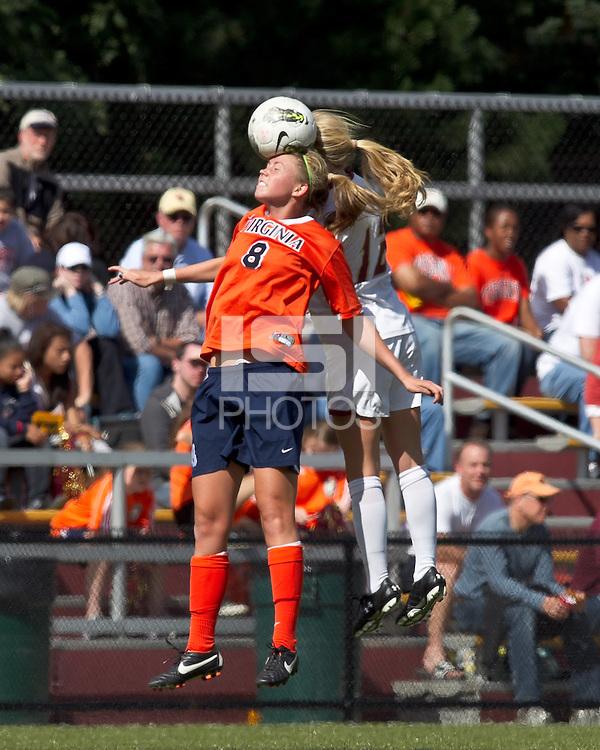 University of Virginia midfielder Julia Roberts (8) and Boston College midfielder Julia Bouchelle (12) battle for head ball. Boston College defeated University of Virginia, 2-0, at the Newton Soccer Field, on September 18, 2011.