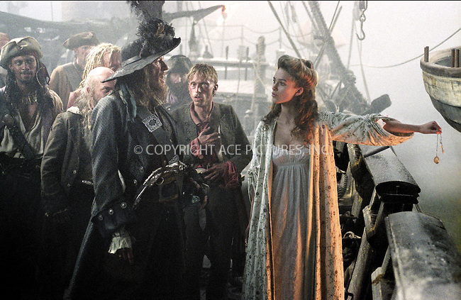 GEOFFREY RUSH and KEIRA KNIGHTLEY on the set of 'Pirates of the Caribbean: The Curse of the Black Pearl.' Ref: TVSL0001. No reproduction rights granted or implied. All rights reserved by copyright holders. Supplied by NY Photo Press.   ....NY Photo Press:  ..phone (646) 267-6913;   ..e-mail: info@nyphotopress.com