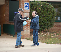Fairfax, VA,November 8, 2016, USA: A Clinton supporter hands a voter a mock voting ballot at one of the   polling sites in Fairfax, VA. Polls in Virginia are open and voters are making their voices heard in the 2016 Presidential elections.  Patsy Lynch/MediaPunch