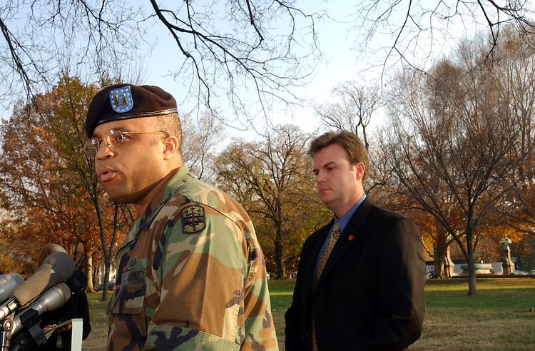 2guard111501 -- Capt. Sheldon Smith of the D.C. National Guard and U.S. Capitol Police spokesman, Dan Nickles, explain the mission of the National Guard troop's on Capitol Hill at a press conference.