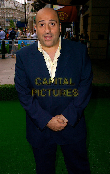"OMID DJALILI.""Over The Hedge"" UK film premiere at Vue West End, London, UK..June 22nd, 2006.Ref: CAN.half length blue suit jacket.www.capitalpictures.com.sales@capitalpictures.com.©Capital Pictures"