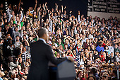 Members of the audience cheer as United States President Barack Obama delivers remarks on the American Jobs Act at Manchester Central High School in Manchester, New Hampshire, November 22, 2011..Mandatory Credit: Pete Souza - White House via CNP