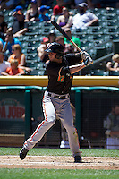 Nick Noonan (12) of the Fresno Grizzlies at bat against the Salt Lake Bees at Smith's Ballpark on May 26, 2014 in Salt Lake City, Utah.  (Stephen Smith/Four Seam Images)
