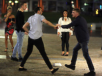 Pictured: A young man (R) is trying to restrain a man fighting  in the early hours of Saturday, 17 December, 2016<br />