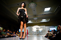 A standing room only crowd watches a model make her turn on the catwalk during the Macy's Runway Fashion Show at La Plaza Mall in McAllen, Texas, Saturday, April 3, 2010. Stores within the La Plaza Mall have done well throughout the economic crisis due to its proximity to Mexico and the influx of Mexican tourists who purchase goods to bring back home. ...PHOTO/ Matt Nager