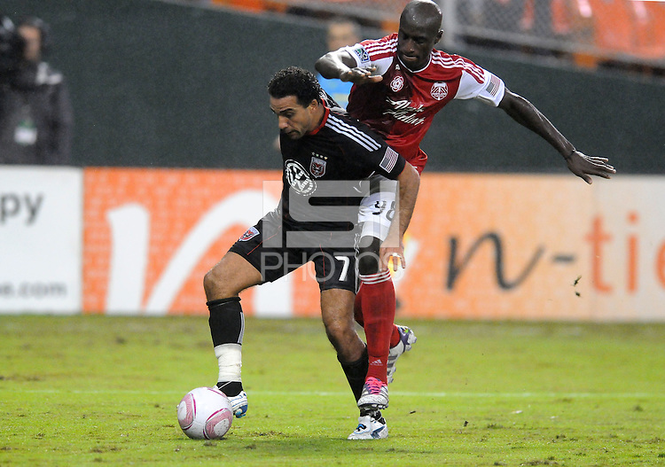 D.C. United forward Dwayne De Rosario (7) goes against Portland Timbers defender Mamadou Danso (98). D.C. United tied The Portland Timbers 1-1at RFK Stadium, Wednesday October 19, 2011.