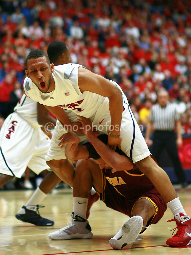 Jan 21, 2009; Tucson, AZ, USA; Arizona Wildcats forward Jamelle Horne (top) reacts to blocking the shot of Arizona State Sun Devils guard Jerren Shipp (below) in the first half of a game against the Arizona State Sun Devils at the McKale Center.  The Sun Devils won the game 53-47.