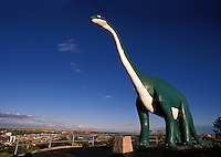 Life-size concrete replica of a brontosaurus in Dinosaur Park on Skyline Drive above downtown Rapid City South Dakota.
