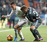 Real Madrid's Lucas Vazquez (l) and Real Sociedad's Kevin Rodrigues during La Liga match. January 29,2017. (ALTERPHOTOS/Acero)